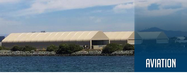 Banner featuring three 100 x 280 aircraft hangar fabric buildings a.k.a. sun shade structures