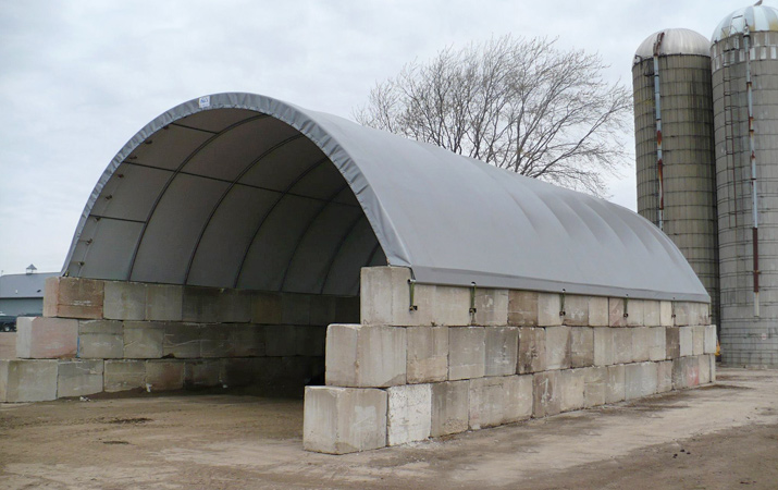 32' x 54' fabric building on blocks can be used for hay, equipment or commodity storage